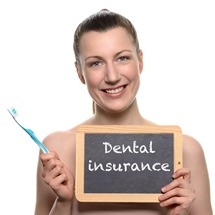 Woman holding dental insurance sign