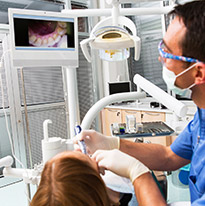 Dentist using an intraoral camera