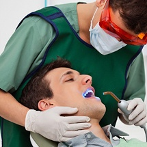 Dentist showing male patient his digital dental x-rays
