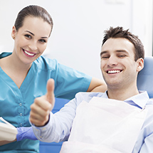 Male patient giving a thumbs up