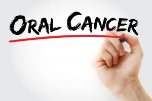 """A person underlining the phrase """"oral cancer."""""""