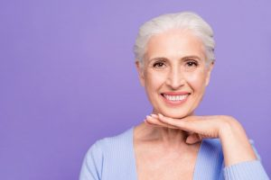 Smiling older woman with dental implants