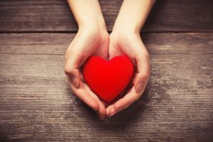 Small heart shape in cupped, outstretched hands.